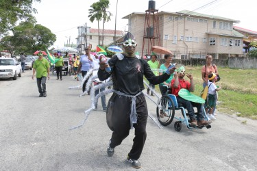 Is it Spiderman? Yes, it's Anansi!  Ptolemy Reid Rehabilitation Centre group during a mini Mash parade today (Photo by Arian Browne)
