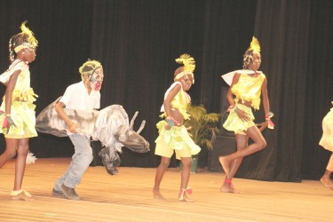 Region Three's Utivlugt Primary's students paying homage to the traditional masquerade at the National Cultural Centre on Wednesday.