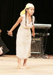 Angel Pearson of Mainstay Lake Primary, Region Two doing `Train yuh pickney' in the dramatic poetry segment of the children's Mashramani contest finals yesterday at the National Cultural Centre.