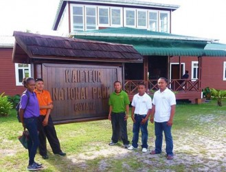 From L to R are Nadine Johnson of Karisparu, Phillip Lewis and Maxwell Basil of Paramakatoi, Thomas Williams of Chenapau, and Senior Warden (acting) LeRoy Vanhercel of Chenapau. (Ministry of Natural Resources photo)