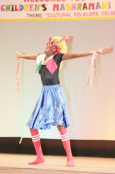 Aliya Moore of North Ruimveldt Primary performing `Mash is we thing' in the dramatic poetry section of the Children's Mashramani contest on Monday at the National Cultural Centre.