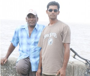George and Gopaul Kumar hanging out at the Zeeburg seawall.