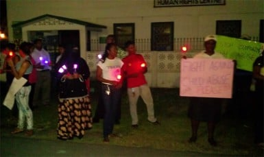 A section of people gathered outside of the GHRA building with candles to speak out against the abuse of a one-year-old baby.