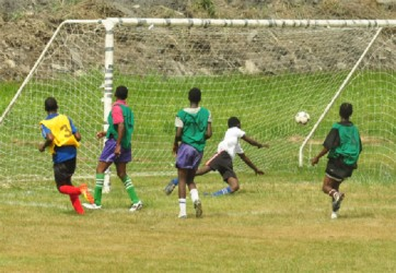 Action in the game between North Ruimveldt and School of the Nations yesterday. (Orlando Charles photo)