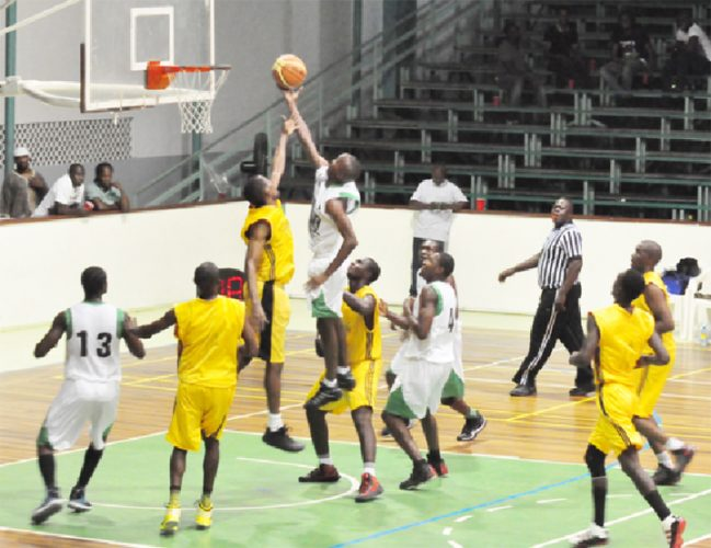 Action in the game between Kings of Linden and Republic Bank Nets Saturday night at the Cliff Anderson Sports Hall. (Orlando Charles photo)
