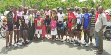 Winners, race officials, sponsors and representatives of the People's Progressive Party following yesterday's staging of the 17th Annual Cheddi Jagan Memorial cycle road race. (Orlando Charles photo)