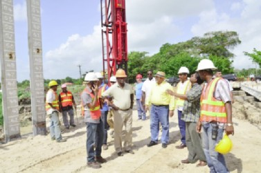 President Donald Ramotar (centre), Minister of Public Works, Robeson Benn (second from left),  Finance Minister, Dr Ashni Singh (second from right) and several engineers at Little Diamond, East Bank Demerara.  (GINA photo)