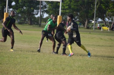 The University of Guyana and the Guyana Defence Force players caught during yesterday's Bounty Farm Products 15-a-side rugby final at the National Park Playfield.