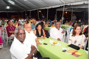 President Donald Ramotar (second from left), First Lady Deolatchmee Ramotar (third from left), Prime Minister Samuel Hinds (second from right), Minister of Public Works Robeson Benn (left) and Minister of Foreign Affairs Carolyn Rodrigues-Birkett at the chowtal samelaan yesterday at the  Guyana International Conference Centre hosted by the first couple. (GINA photo)