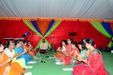 A women's group taking part in the chowtal samelaan at the Guyana International Conference Centre yesterday (GINA photo)