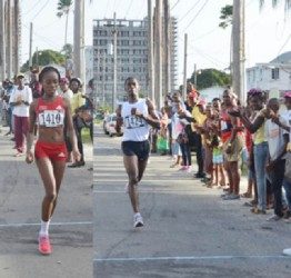 All alone! Male and female Wartsila 20K road race Cleveland Forde and Tanya Nero are all alone as they approach the finish line on Sunday. (Orlando Charles photos)