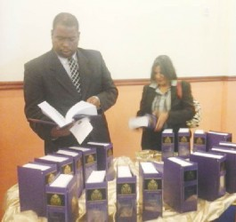 Members of the legal fraternity viewing the copies of revised law books