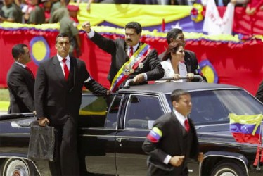 Venezuela's President Nicolas Maduro (C) arrives at a military parade to commemorate the first anniversary of the death of Venezuela's late president Hugo Chavez in Caracas March 5, 2014. Credit: Reuters/Jorge Silva