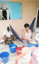 Members of the Sirpaul family  preparing shrimp for lunch