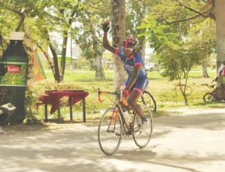Team United's Hamzah Eastman about to cross the finish line in the 35-lap event of the Caribbean International Distributors Inc. (CIDI) 11-race cycling programme which was staged at the National Park yesterday. (Orlando Charles photo)