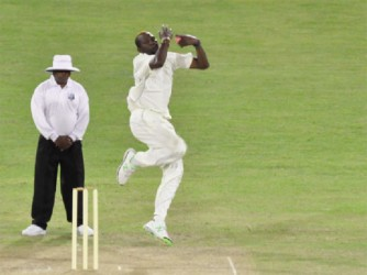 Sulieman Benn takes a simple return catch off Keon Joseph as defending champions Barbados completed a comfortable 136-run win over Guyana at the National Stadium at Providence yesterday. (Orlando Charles photo)