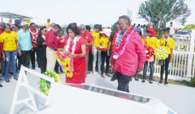 First Lady Deolatchmee Ramotar laying a wreath at the memorial. Prime Minister Sam Hinds is at right.