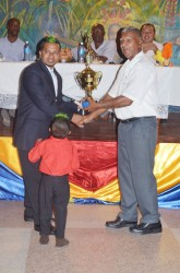 Pooran Seeraj (left), receiving his prize for topping the Chutney competition