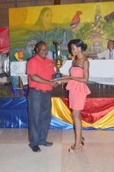 Junior Calypso Monarch, Shontelle Gittens (right) receiving her prize