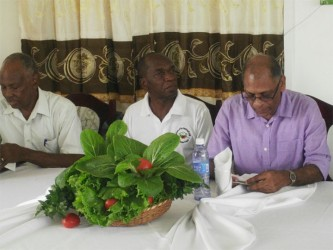 From left are Roland Fletcher of CASRI, Kelvin Craig and Agriculture Minister, Dr Leslie Ramsammy