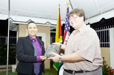 In recognition of her exceptional courage and leadership in advocating for women's rights and empowerment and raising public awareness to protect the human rights of Lesbian, Gay, Bisexual and Transgender persons, Human Rights activist Zenita Nicholson was last evening honoured by the United States Embassy. In photo Nicholson receives the award from Chargé d' Affaires Bryan Hunt.