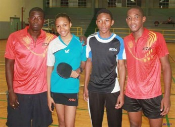 Coach Idi Lewis, left and his charges (from left) Chelsea Edghill, Kyle Edghill and Shemar Britton.