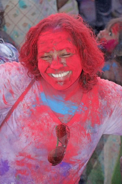 Red is definitely her colour! A Phagwah reveller at Inspire Inc's activity at the Guyana National Stadium, Providence yesterday.