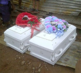 The remains of the five La Cruz family members were divided between two caskets.