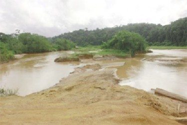 The polluted Konawaruk River with the banks dug up in September last year (SN file photo).