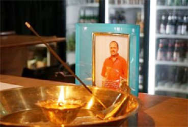 A photo of Peter Pitamber in a tribute on the bar of Calypso Hut, the restaurant he ran for over 20 years. (Brampton Guardian photo)