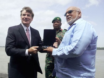 US Ambassador D. Brent Hardt (left) hands over the keys of the three vessels to President Donald Ramotar, as Chief of Staff of the Guyana Defence Force, Brigadier Mark Phillips looks on.