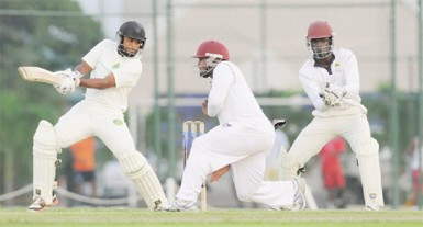 Guyana's Assad Fudadin cuts during his top score of 71 yesterday. (Photo courtesy of WICB media)