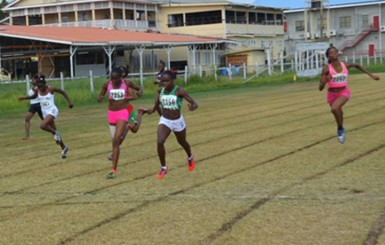 Jevina Sampson about the cross the finish line ahead of Avon Samuels in the 200m under-18 Girls event.