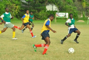 Action in the match between Charlestown Secondary and Kingston High. (Orlando Charles photo