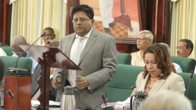 Finance Minister Dr Ashni Singh reading the 2014 national budget in the National Assembly yesterday (Photo by Arian Browne)