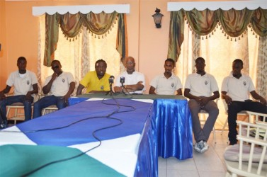 Alpha United officials and players at yesterday's press conference from left to right- Andrew Murray Jr., Kithson Bain, Coach Wayne Dover, Club President Odinga Lumumba, Gregory Richardson, Ronson Williams and Kirk Duckworth.