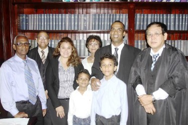 (From left to right) Lloyd Conway Senior, Senior Counsel Robin Stoby, Dinte Conway (wife), Kaden Conway, Sylvia Conway (mother), Ethan Conway, Lloyd Mark Conway and Chief Justice Ian Chang.