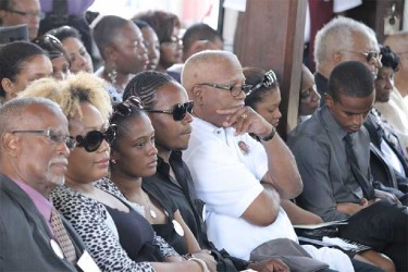 Family members of the late Deborah Backer at her funeral.