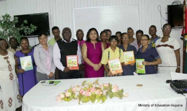 Minister of Education Priya Manickchand (centre) with the contributors to the texts (Ministry of Education photo)