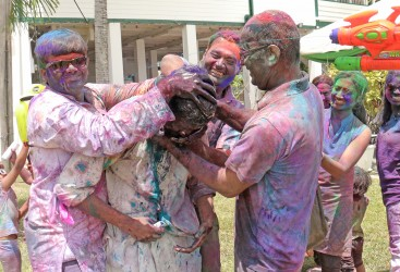 Trapped! Several people ganged up on this man at the Indian Cultural Centre making sure he was well and truly coloured during today's 'Festival of Colours'.