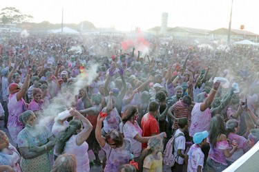 Achoo! Clouds of powder rising in the air at the Guyana National Stadium, Providence on Monday as Phagwah was celebrated by thousands at the Inspire Inc's activity. (Photo by Arian Browne)