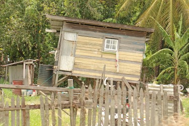 A leaning house along the Railway Embankment at Lusignan.