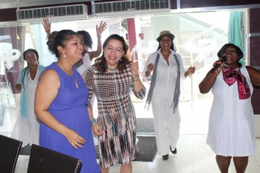 Education Minister Priya Manickchand (left) and Foreign Minister Carolyn Rodrigues-Birkett (second from left) being entertained at the lunch. (Ministry of Education photo)