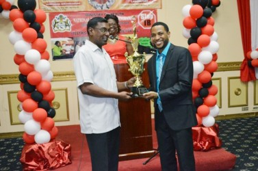 Dr Roscoe Mc Donald (right) receives the Dr. Motilall Award for TB HIV service at the Pegasus Hotel yesterday. (GINA photo)