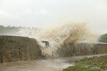 High waves pounding the crumbling Mosquito Hall, Mahaica sea defence yesterday afternoon.