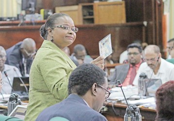 Volda Lawrence holding up a copy of the DVD `Guyanese Girls Gone Wild Part Two'