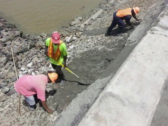 Public Works workers patching up a section of the Mosquito Hall river defence which collapsed on Tuesday.