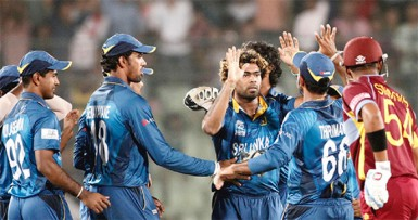 Sri Lankan players celebrate after the fall of Dwayne Smith's wicket. (WICB photo)