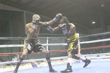 WBC CABOFE Flyweight champion, Dexter Marques (left) on the attack against Jamaican challenger, Rudolph Hedge.