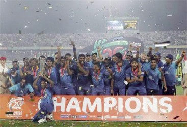 Sri Lanka's players celebrate with the trophy after winning the ICC Twenty20 World Cup cricket title after beating India at the Sher-E-Bangla National Cricket Stadium in Dhaka yesterday.